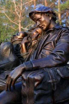 """""""Departure"""", installed in the park near the library in Loveland, CO, is a life size bronze sculpture by the American artist, George Lundeen. According to the artist, """"The original piece came from a sketch I did in the Rome train station. There were a couple of kids across from me on the marble floor. It became the first life-size piece I ever did""""."""