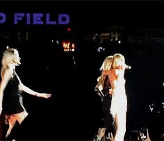 Taylor Swift performing Style with Gigi Hadid & Martha Hunt on stage - 1989 World Tour: Detroit, Michigan.