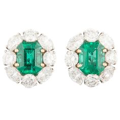 Bayco Emerald Diamond Gold Platinum Stud Earrings | From a unique collection of vintage clip-on earrings at https://www.1stdibs.com/jewelry/earrings/clip-on-earrings/