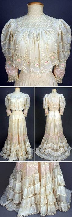 White tea gown with Valenciennnes lace, ca. White cotton lawn with lace high neck and bands in a pattern of loops and bows, having a band of polychrome embroidered roses at lower bodice, sleeve and skirt. Sleeves and skirt have scalloped inserts of Edwardian Clothing, Edwardian Dress, Antique Clothing, Historical Clothing, Edwardian Era, Victorian Dresses, Historical Dress, Vintage Outfits, Vintage Gowns