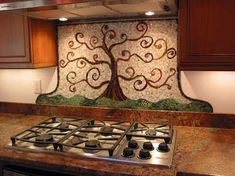 one of a kind backsplash using mosaic tile