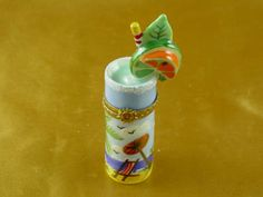 http://www.limogesfactory.com/limoges-boxes-and-figurines/tropical-cocktail-glass-P22401.html Tropical cocktail glass