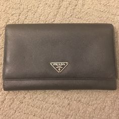 Prada Saffiano leather continental wallet 100% Authentic used with love, Prada Saffiano Leather Continental Wallet. Small scratch on the very bottom unnoticeable unless ur feeling or really looking for it, overall wallet is still in great condition! I still have the authenticity verification cards that will come with the wallet. Willing to take reasonable offers! Prada Bags Wallets