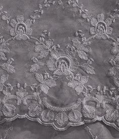 White. Lace tablecloth with embroidery.