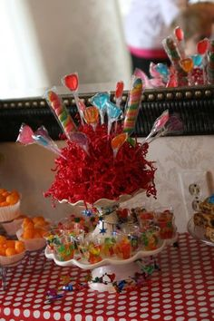 cute idea for kids birthday party...$ store shot glasses for individual candy servings!!