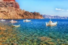 Boats in the tiny island of Thirassia, opposite Santorini