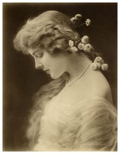 Beautiful introspective girl, probably turn of the 20th century