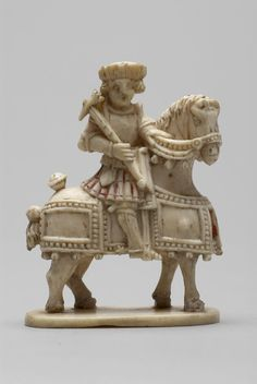 Description  Chess-piece; ivory; carved; armed knight riding on a caparisoned horse on an ivory base; traces of red paint. Date      16thC