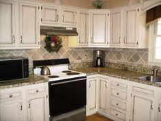 That backsplash is painted joint compound. Whaaaat.   //// My $17.00 kitchen makeover - Kitchen Designs - Decorating Ideas - HGTV Rate My Space ||