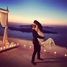 He proposed on a rooftop in Santorini, and it's so amazing! You have to see the full proposal and video.