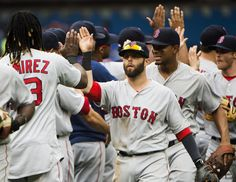 Dustin Pedroia (middle) played a central role in the Red Sox' 11-inning victory Sunday, driving in the go-ahead run.
