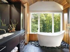master bathroom renovation tips... amazing wood and stone flooring AND tub!