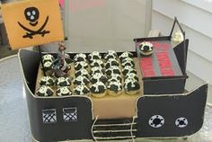 a pirate ship cupcake party display