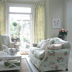 Cottage garden living room - Green walls and white paintwork are a backdrop for classic country furniture.