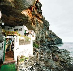 Carved into the volcanic rock on Spain's Canary Island of Tenerife, this unique cave dwelling is a great summer escape! Tenerife, Troglodytes, Portugal, Waterfront Cottage, Old Mansions, Stone Houses, Canary Islands, Oh The Places You'll Go, Strand