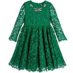 Rich, emerald green lace dress by Dolce & Gabbana, featuring amazing jewelled dragonfly appliqués around the neck. Inspired by the womenswear collection, this lovely dress has a lace overlay in a floral design, with a gathered skirt and scalloped edge. The lace sleeves are see-through and there is a covered zip fastener at the back. The silky satin, emerald green lining is trimmed in delicate lace.