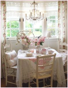 WAY too girly for my taste as an everyday kitchen nook but I would be happy to have tea with my girlfriends here! Lol