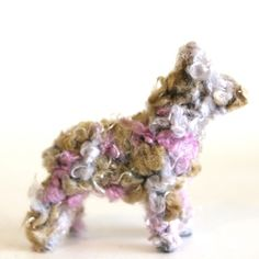 Fuzzy Animals covered in art yarn from dollar store animals