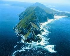 Cape Point, South Africa, located at the southernmost tip of the Cape peninsula on the African continent, encompasses a beautiful sea and coastline. Some of the highest points in the world can be found within Cape Point with its treacherous cliffs. South Africa Tours, Cape Town South Africa, Two Oceans Meet, Places To Travel, Places To See, Out Of Africa, Africa Travel, Aerial View, Wonders Of The World