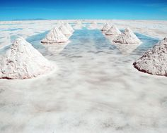 Salar de Uyuni in southwestern Bolivia. This geological wonder is the largest dried salt lake, located more than 3000 m over the Andes, with area greater than 10 000 km ².    This unique landscape formed by multiple layers of salt and water. In the middle of the marsh salt thickness is 10 m. When it rains, Salar de Uyuni sinking and looks like a huge mirror. It is believed that it was formed at the confluence of geothermal and saline lakes.