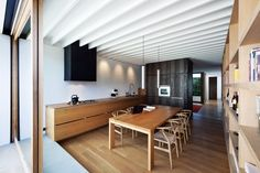 American oak is used for the floors and as a veneer on all joinery - Layan Design Group, Hawthorn House