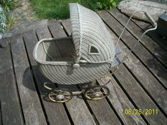 """Antique Wicker Vintage Baby Doll Buggy 17"""" plus Hood circa 1920-30's era.  My Mother has this in a natural brown tone. It is beautiful!"""