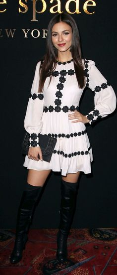 Who made Victoria Justice's black thigh high boots, clutch handbag, jewelry, and long sleeve dress?