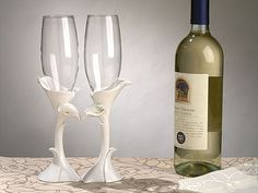 "alla lily toasting glasses . A set of 2 calla lily design toasting glasses . Comes packaged 1 set in a gift box. Each glass measures 10"" high.The shipping weight is 1.5 lbs per set."