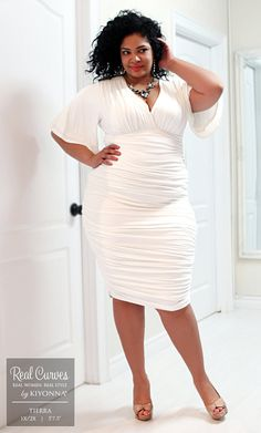 """Real Curve Cutie and model, Tierra (5'7.5"""" and a size 1x/2x) models our curve hugging plus size Rumor Ruched Dress for a stylish Canadian boutique, SexyPlus Clothing. Neutral heels and a colorful necklace really complements the beautiful ivory color. Find your sexy dress at www.kiyonna.com. #KiyonnaPlusYou #MadeintheUSA"""