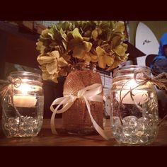 DIY hydrangea, burlap, and twine wedding centerpieces.