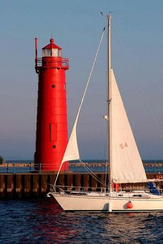 2 favorite things- a sailboat & a lighthouse!