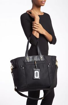 Because a diaper bag doesn't have to look like one.