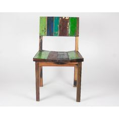 The perfect blend of minimalist and decorative, this chair from Ecologica Furniture matches a rugged finish with contemporary hues. Constructed of reclaimed  tropical hardwood, this chair features a slightly curved seat.