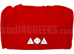 Red Delta Phi Delta duffel bag with Greek letters across the front. It has enough room for a day at the gym or an overnight adventure.