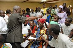 The ability to take part in democracy is key to the rule of law. In this photo from Côte d'Ivoire, a court official distributes application forms to residents beginning the process of getting identification documents ahead of elections. More info on the UN's rule of law work: http://unrol.org/article.aspx?article_id=24. Photo credit: UN Photo/Ky Chung