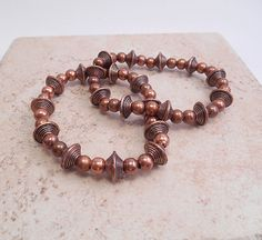 A delightful stretch bracelet of mixed copper tone metals. Just a touch chunky but still very easy to wear. This bracelet will add a bit of 'spiffy' to any outfit! B-122 $24. Click to view on my Etsy site at:  https://www.etsy.com/listing/208466822/mixed-metals-in-copper-tones-stretch?ref=shop_home_active_1 or contact me directly at ByEJewelry@gmail.com.