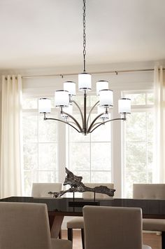 The Prospect Park Collection by Feiss features a rich, two-tone finish to highlight the details of the silhouette, and each glass shade boasts metal bands at the top and bottom to add a bit of formality. Unexpected crystal on each stem elevates the tailored look to add a touch of glamour to your dining room.