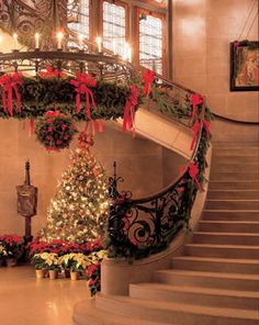 Christmas at Biltmore House. The Grand Staircase is twined with live  evergreen, filling the 250-room Biltmore  House with the scent of Christmas.