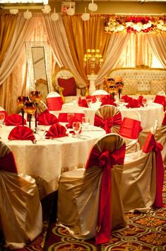 Gold and Champagne Backdrop with red accents Available @ www.uniquedesignandevents.com