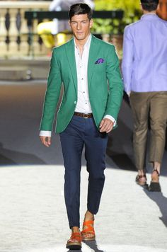 Green jacket & navy trousers with a white shirt #uber sport