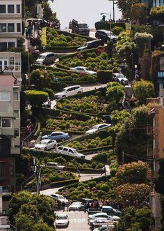San Francisco, CA - Because of the 27% grade, Lombard Street, between Hyde and Leavenworth Streets, was constructed with sharp curves to switchback down the one-way hill which was too steep for both pedestrians and cars.