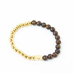 Accessories for the modern man who pays attention to details. Men's beaded bracelet with gold stainless steel beads & bronzite.