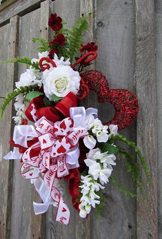 Valentine Swag, Valentines Day Wreath, Heart Wreath, Designer Valentine Swag, Elegant Valentine Wreath, Rose Floral Valentine Swag Hearts and Roses Valentines Day Swag. An elegant bouquet of Roses and Wisteria in soft winter white and rich cardinal red rest upon a bed of Boston