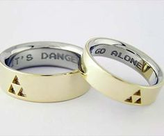 """It's dangerous to go alone - take these Legend Of Zelda wedding rings! These geeky wedding bands were custom made for Reddit user <a href=""""http://www.reddit.com/r/gaming/comments/14aox9/just_my_wedding_rings_its_dangerous_to_go_alone/"""" rel=""""nofollow"""" target=""""_blank"""">oneyeartrip</a> by Transylvanian goldsmith Zsolt, and features the words """"It's Dangerous To Go Alone"""" engraved across the two rings."""