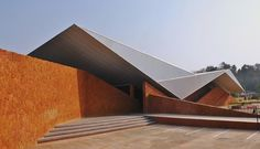 Image 1 of 24 from gallery of Valpoi Busstand and Community Hall / Rahul Deshpande and Associates. Courtesy of Rahul Deshpande Cantilever Architecture, Amazing Architecture, Architecture Details, Interior Architecture, Roof Shapes, Small Buildings, Interesting Buildings, Roof Design, House Roof