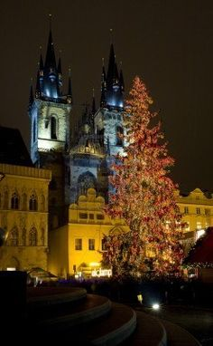 Old Town Square at Christmas time, Prague, Czech Republic St. Nicholas Church in background
