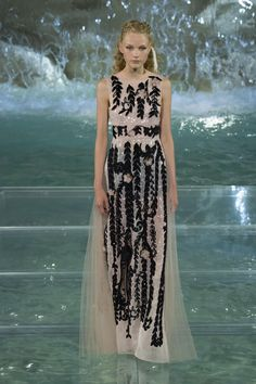 cf71c8b9b5 A look from the Fendi 90 Year show at the Trevi Fountain in Rome. Photo