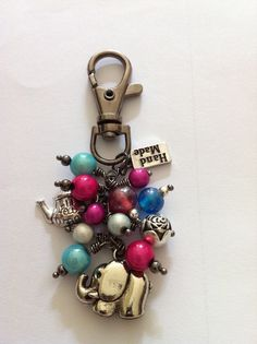 Handmade Bag Charm with Gunmetal findings and a mixture of beads & charms. By Lady Barefoot.