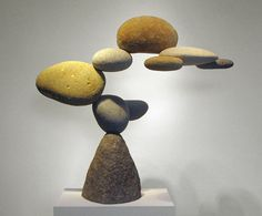 """The art of sculptor Woods Davy is both inspired by nature and composed of natural elements. The artist, who lives and works in Venice, California, creates what he calls a sense of """"Western Zen"""" with his gravity-defying rock sculptures. His Cantamar and Granite series feature a number of collected stones arranged in an impossible balancing act, leaving one to reflect on its unnatural configuration and one's own spirituality."""