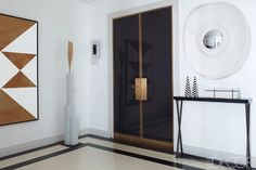 black lacquered doors & brass hardware
